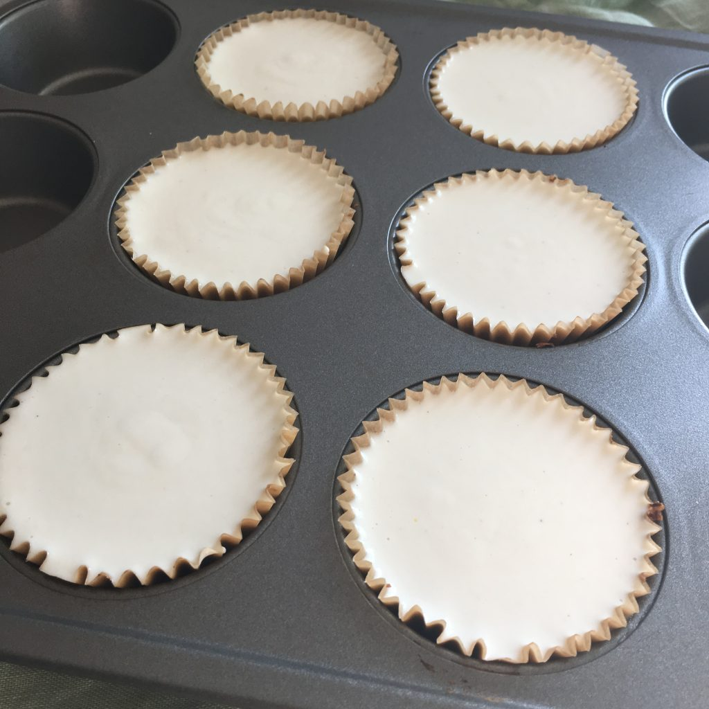 Muffin tins filled with low FODMAP dairy-free cheesecakes