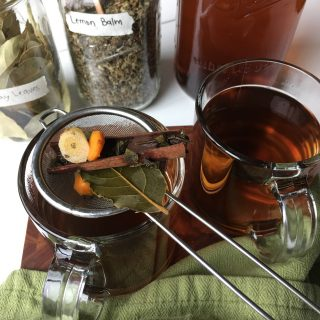 Glass mugs filled with homemade Caribbean herbal tea