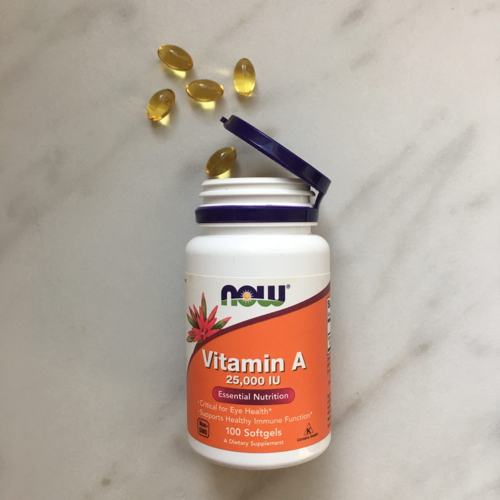 Bottle of vitamin A gel capsules used to heal my warts naturally